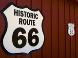 Close-Up of Route 66 Sign on Wall , Route 66, Photographic Print by Simon Montgomery