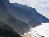 The Fluted Ridges of the Na Pali Coast Above the Crashing Surf on the North Shore of Kauai, Hawaii. Photographic Print by Sergio Ballivian
