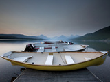 Glacier National Park- Boats Rest on a Dock in Front of Lake Mcdonald. Photographic Print by Ian Shive