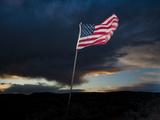 American Flag Blowing in Wind at Dusk in the Desert Photographic Print by James Shive