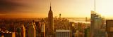 Panoramavy av Manhattan med Empire State Building i solnedgång Fotografiskt tryck av Philippe Hugonnard