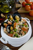 Seafood Rice with Mussels, Shrimps, Tomato, Olives, Peas, Italian Cuisine, Italy Papier Photo par Nico Tondini