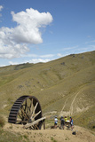 Waterwheel, Gold Mine, Mountain Bikers, Bannockburn, Central Otago, New Zealand Photographic Print by David Wall