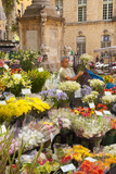 Man Selling Flowers on Market Day in Aix-En-Provence, France Photographic Print by Brian Jannsen