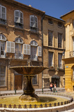 Two Women Walk Past the Fountain at Place De Albertas in Aix-En-Provence, France Photographic Print by Brian Jannsen