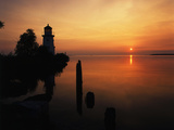 View of Sea and Lighthouse at Sunset, Cheboygan, Michigan, USA Photographic Print by Adam Jones