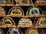 Stack of Lobster Traps at Neil's Harbor, Cape Breton, Nova Scotia, Canada Photographic Print by Walter Bibikow