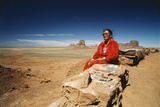 USA, Arizona, Woman Sitting with Bead Necklaces Near Monument Valley Photographic Print by Dave Bartruff