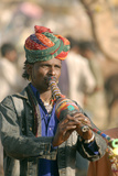 Snake Charmer Plays Flute-Like Instrument, Pushkar Camel Fair, Rajasthan, India Photographic Print by David Noyes