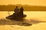 Fishermen Boating Toward the Laguna Madre, Texas, USA Photographic Print by Larry Ditto