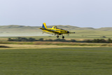 Crop Duster Airplane Spraying Farm Field Near Mott, North Dakota, USA Photographic Print by Chuck Haney