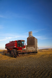 Farm Combine Parked by Silo, Palouse Country, Washington, USA Photographic Print by Terry Eggers