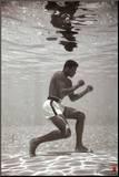 Mohammed Ali bokst onder water Kunst op hout