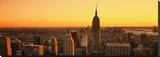 Empire State Sunset Stretched Canvas Print by Dale MacMillan