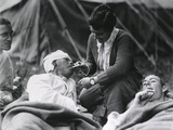 Red Cross Worker Helping a Wounded WW1 Soldier with His Cigarette in France Photo