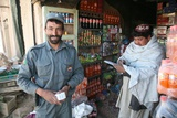 Afghan National Police Officer Shops in Now Zad, Helmand Province, 2010 Photographic Print
