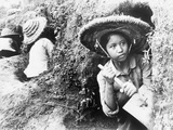 High School Girls Digging Air Raid Shelters in a Hillside in Hanoi, North Vietnam, 1965-1966 Photo