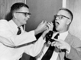 Dr. Harry Williams Squirts LSD into Dr. Carl Pfeiffer's Mouth, 1955 Photo