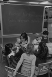 Children and their Teacher in a Bilingual Classroom in the Washington D.C., 1978 Posters