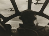 Two B-29 Super-Fortresses Drop Bombs over Malaya as Seen from the Cockpit of Third Bomber, 1943-45 Print