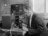 Technologist Operating a Telephone Connected to Electronic Equipment, 1925 Photo