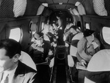 Stylishly Dressed Passengers Seated in a Commercial Flight in the 1930s Posters