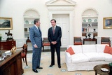 President Reagan with Pat Buchanan in the Oval Office, March 19, 1982 Photo