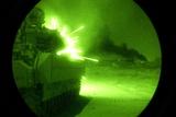Night Vision of Bradley Fighting Vehicle Firing Guns in Iraq, Sept. 2004 Photo