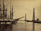 Obelisks on Shore and Ships Moored at the Port Said Entrance to the Suez Canal. 1860 Posters