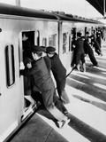 Japanese Students Employed as Uniformed 'Pushers' Cramming Commuter Cars, 1962 Photo