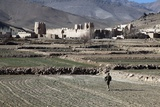 U.S. Soldier Walks in an Afghan Field Near Dahanah Village, Wardak Province, 2010 Photographic Print
