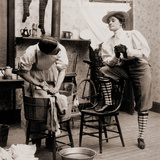 Woman Smoking and Wearing Knickers as a Man Drudges over Laundry, 1901 Posters