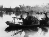 Viet Cong Guerrillas in Small Boats Patrol the Saigon River in South Vietnam Photo
