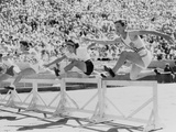 Mildred 'Babe' Didrikson, Running the 80-Meter Hurdles, at the 1932 Olympics Photo