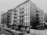 East Harlem's 100th St. with a Large Tenement Apartment Building in NYC, 1964 Poster