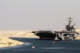 Aircraft Carrier USS Harry S. Truman Passes Underneath the Suez Canal Bridge, 2010 Photo