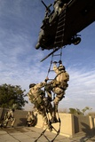 US Air Force Rescue Squadron Climb into a Helicopter, Baghdad, Iraq, Dec. 2004 Photo