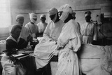 Masked Surgeons Operate While a Nurse Administers Ether, Ca. 1920 Photo