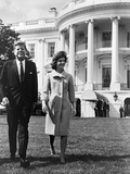 President and Mrs. John F. Kennedy Walking on the South Lawn of the White House on April 16, 1962 Photo
