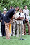 Kareem Abdul Jabba Bends over to Speak in the Microphone Near Ronald Reagan, 1985 Photographic Print