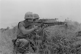 US Marine Machine Gunner and Rifleman Fire at the Enemy, Near DMZ, Vietnam, 1967 Photo