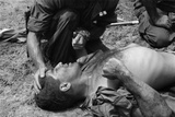 Vietnam War. Us Marine Wounded by a Viet Cong Booby Trap is Comforted by a Fellow Marine, 1967 Posters
