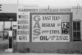 Sign Advertising Alcoholic Beverages and Gasoline Prices, Waco, Texas, 1939 Print