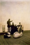 Immigrant Family with Luggage on a Dock, Looking Out over the Water, Ca. 1912 Photo
