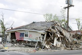 Flag on the Ruins of a Barber Shop in New Orleans after Hurricane Katrina 2005 Photo