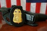 Contemporary FBI Badge and Gun with American Flag Photo