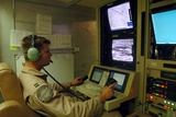 Air Force Officer Maneuvers a Predator Reconnaissance Drone over Iraq, 2004 Photographic Print