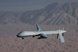 The Predator Drone Carrying Hellfire Missiles in Flight, Dec. 16, 2008 Photo