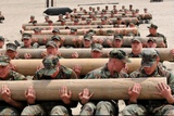 Navy SEAL Candidates Train with a 600-Pound Log, 2011 Stampa fotografica