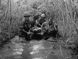 US Soldiers Carry a Wounded Comrade Through a Swampy Area in Vietnam, 1969 Poster